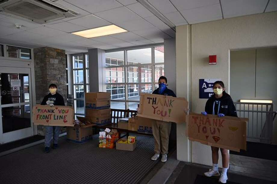 Our Lady of Fatima Catholic Academy students hold signs thanking hospital and other front-line workers during the COVID-19 pandemic. Photo: Contributed Photo / Our Lady Of Fatima Academy / Wilton Bulletin Contributed