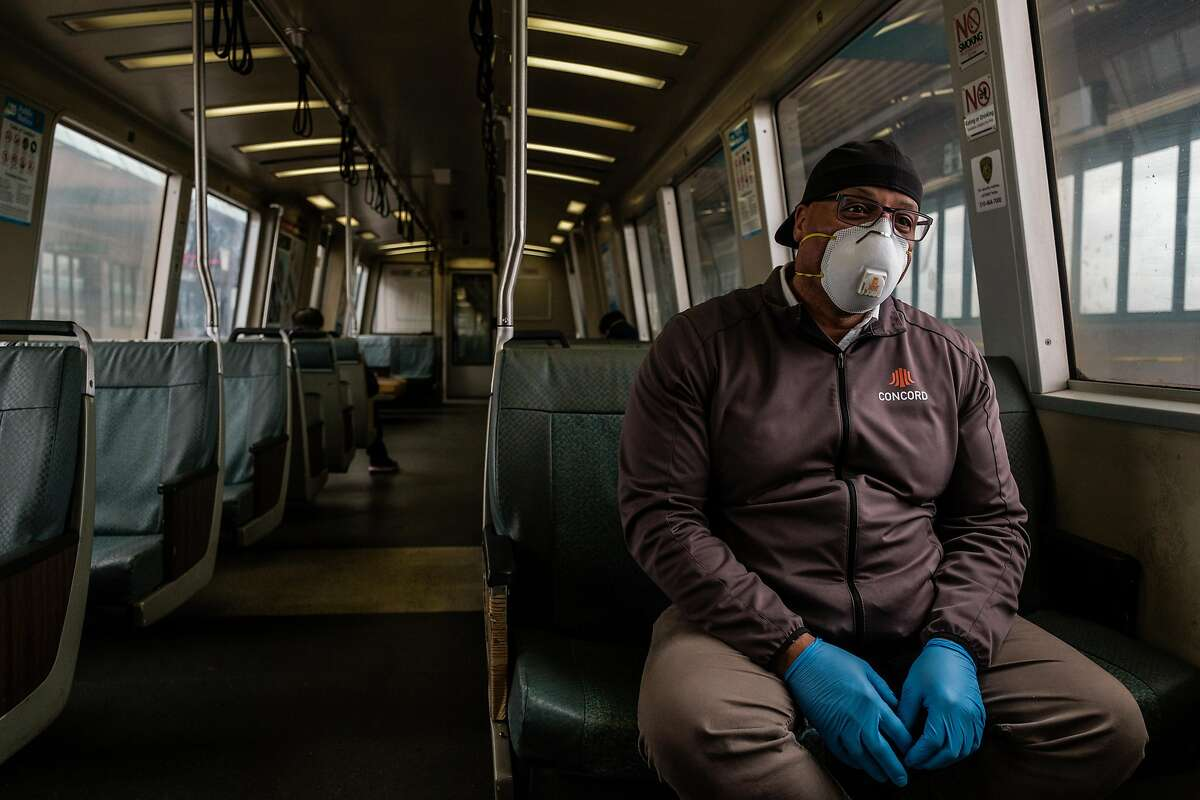 Chase Bronson who is a fire systems inspector and therefore considered an essential service worker rides BART in San Francisco, Calif. on Thursday April 16, 2020.