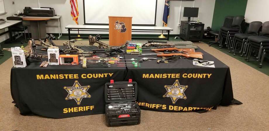 Police found stolen items in a vehicle after a traffic stop. Items include rifles, pistols, crossbows, compound bows, game cameras and fishing equipment after a series of breaking and entering complaints in Manistee County. (Courtesy photo)