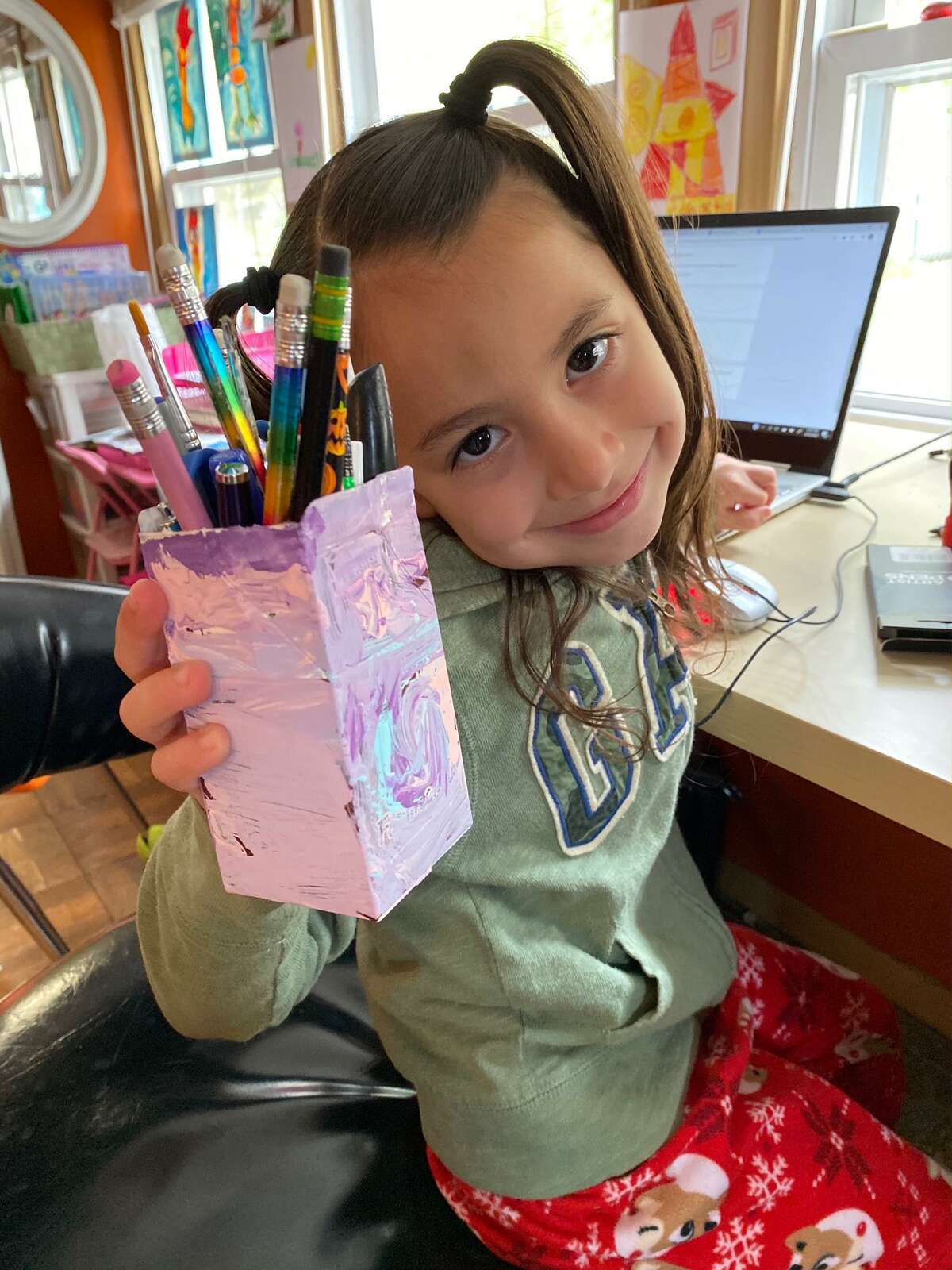 Long Hill School kindergartner Madelyn Gelsi searched for things around the house to recycle and made a pencil holder as part of the school's Earth Day work on Wednesday, April 22.