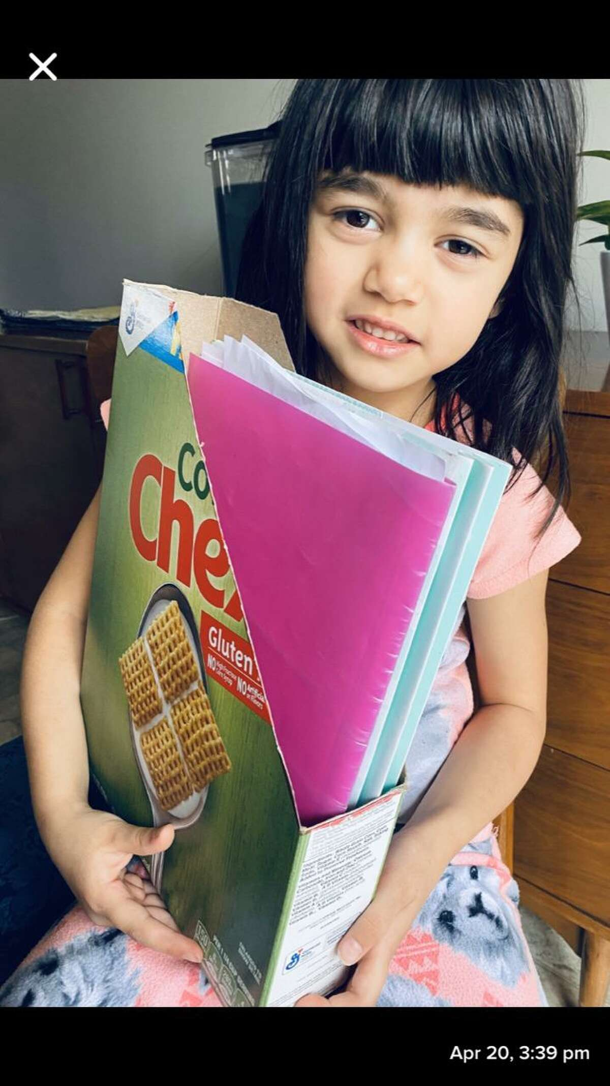 Long Hill School kindergartner Audrey Weaver who reused a cereal box for a book holder on Earth Day, Wednesday, April 22.