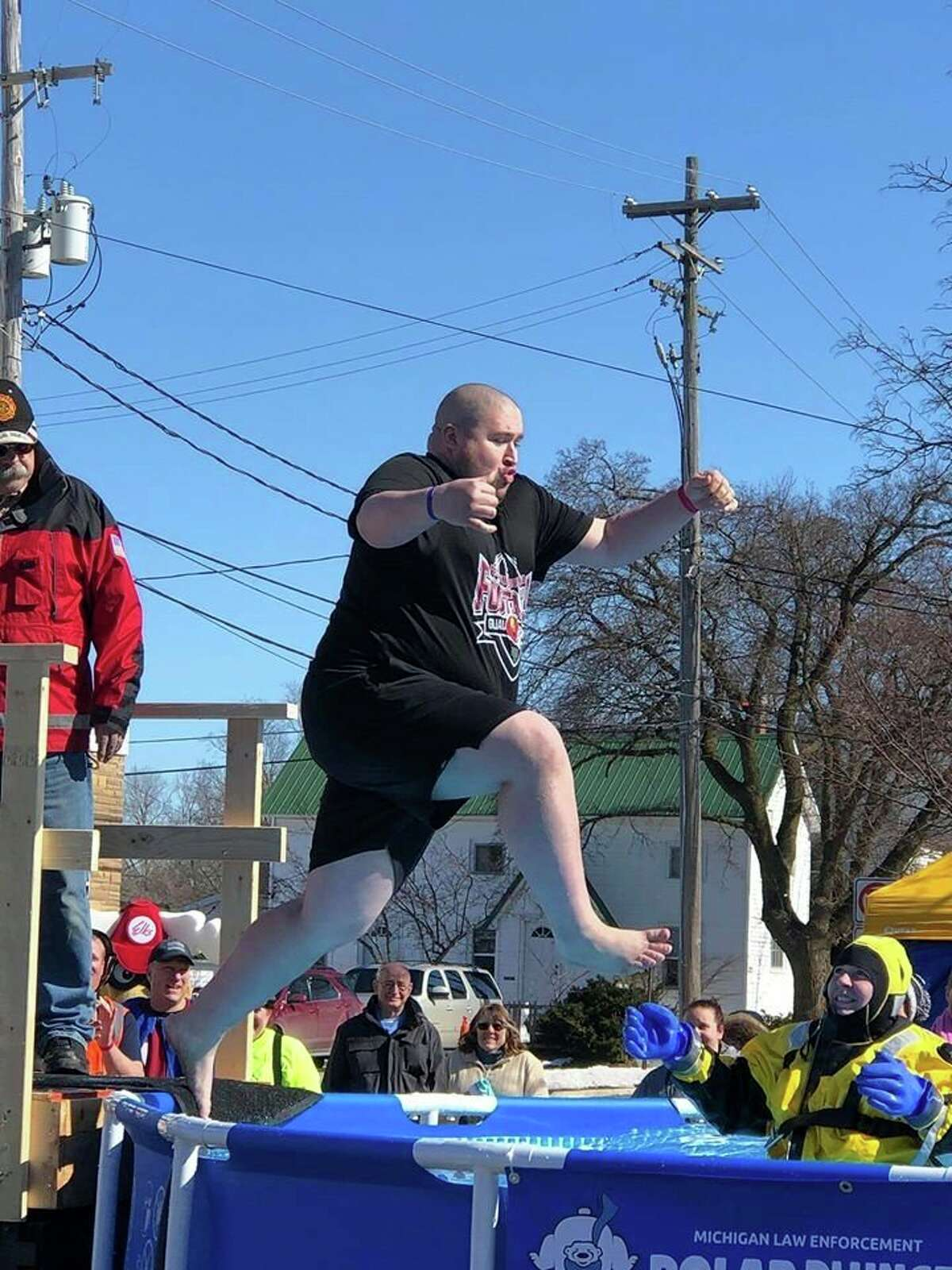 Borders jumps into freezing water during this year's Polar Plunge. This event is one of many ways he stays involved in the community. (Courtesy photo)