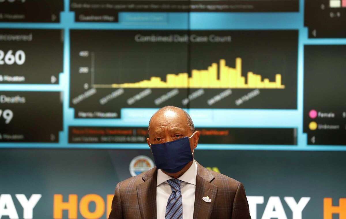 Mayor Sylvester Turner wears a mask as he spoke at a news conference to provide COVID-19 announcements and updates, including the new rules requiring everyone to wear masks while outside, in Houston, Wednesday, April 22, 2020.