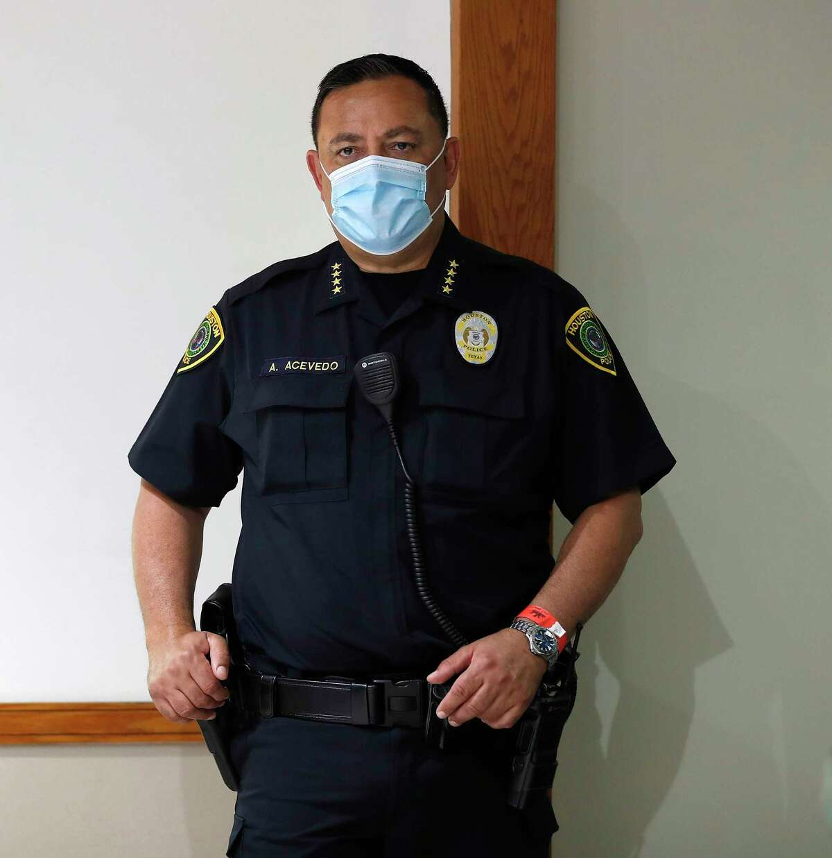 Houston Police Chief Art Acevedo wears a mask as he listened as Mayor Sylvester Turner joined Harris County Judge Lina Hidalgo at a news conference to provide COVID-19 announcements and updates, including the new rules requiring everyone to wear masks while outside, in Houston, Wednesday, April 22, 2020.