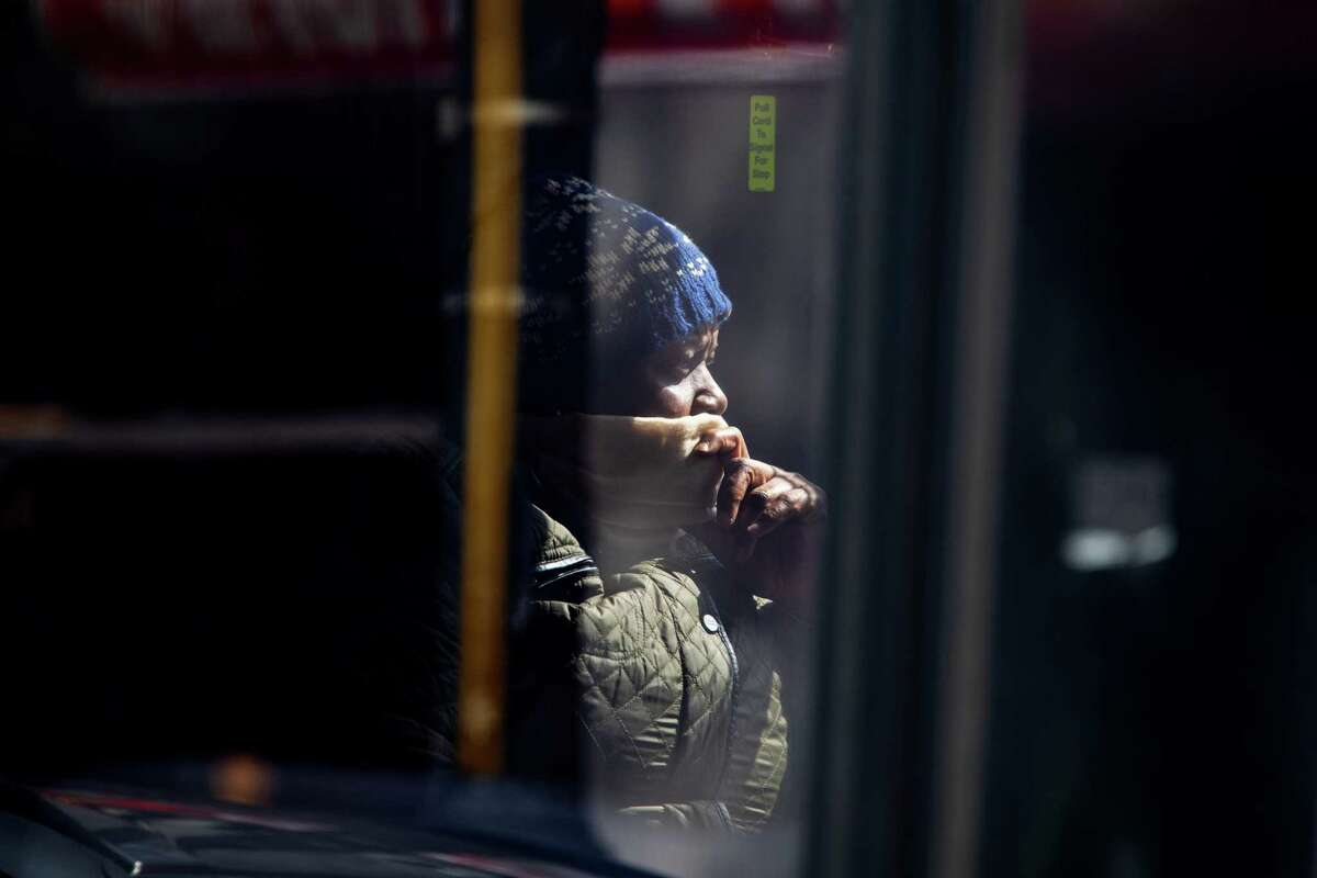A woman rides a bus in the Bronx, New York, on April 6, 2020.