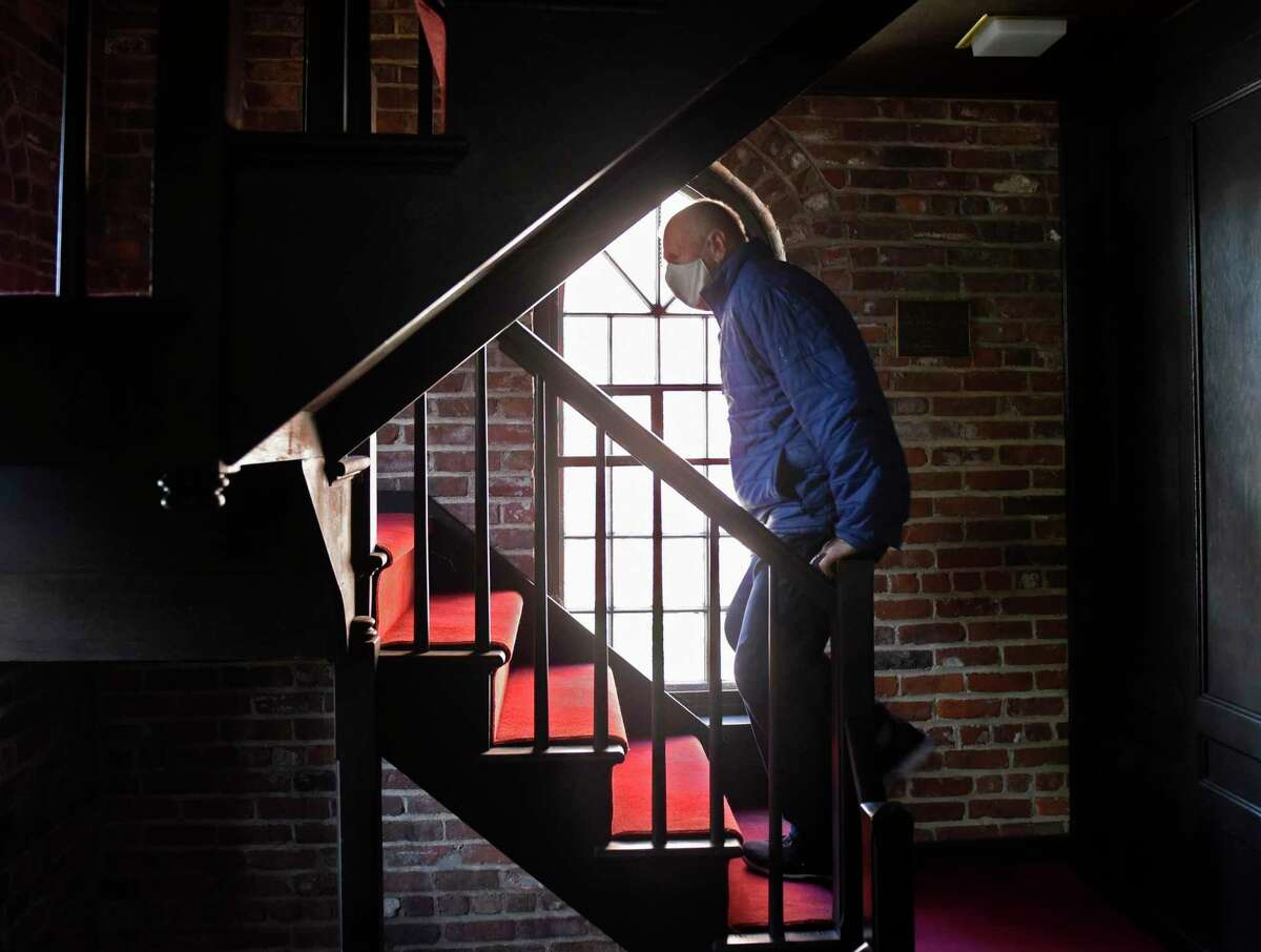 Senior Pastor Lloyd Syvertsen climbs the stairs of the chapel at Greenwich Baptist Church in Greenwich, Conn. Wednesday, April 22, 2020. Greenwich Baptist Church joined several other local places of worship in chiming their bells at noon to commemorate the 50th anniversary of Earth Day.