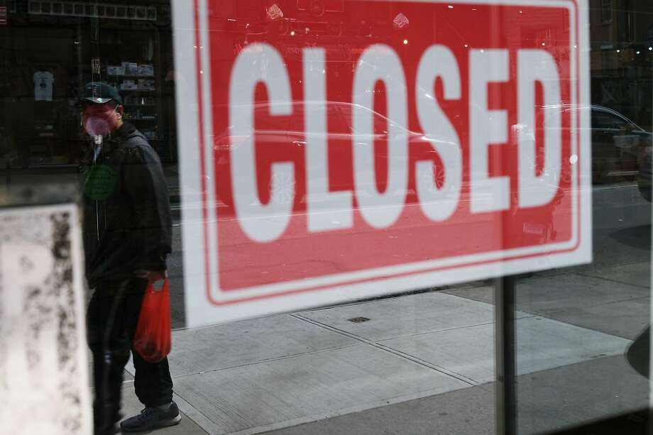 A store stands closed as the coronavirus keeps financial markets and businesses mostly closed on April 21, 2020 in New York City. New York City, which has been the hardest hit city in America from COVID-19, is just starting to see a slowdown in hospital visits and a lowering of the daily death rate from the virus. Photo: Spencer Platt, Getty Images