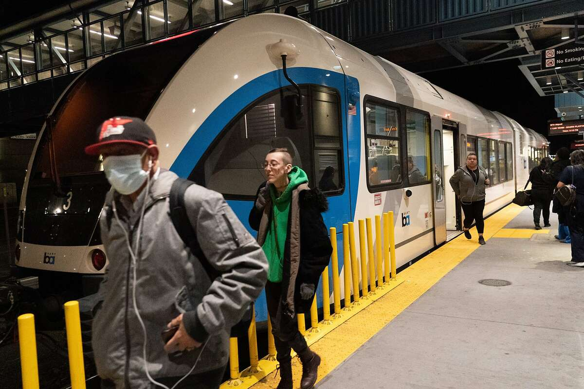 Passengers get off at the Antioch BART station on Thursday, March 12, 2020, in Antioch, Calif.