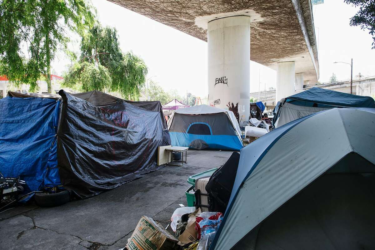 Tents are seen at a homeless encampment underneath Interstate 580 in Oakland, Calif, on Friday, April 22, 2020.