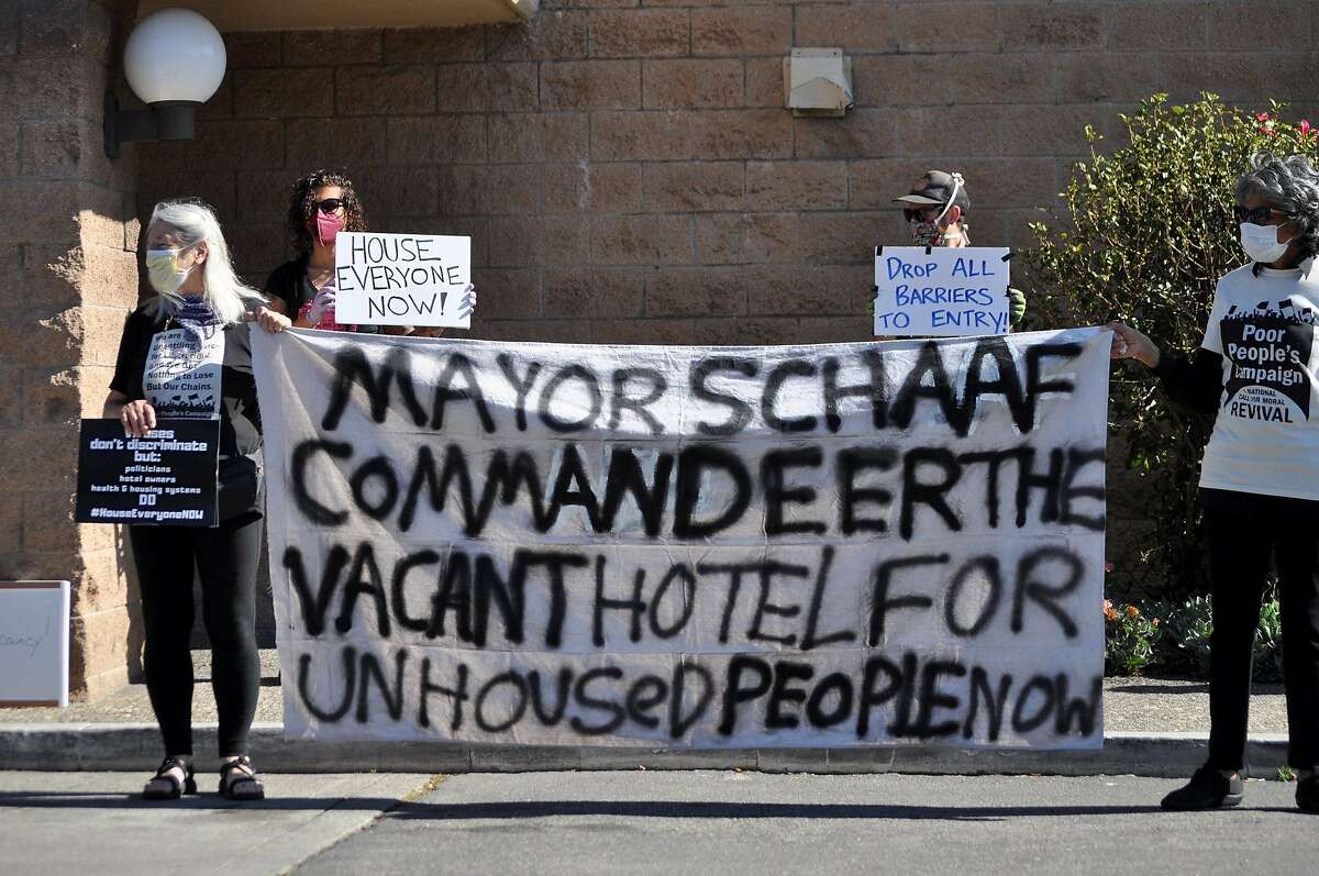 Homeless advocates urge city and county officials to fill empty hotels with homeless people the homeless outside a Days Inn in Oakland, Calif. on April 15.