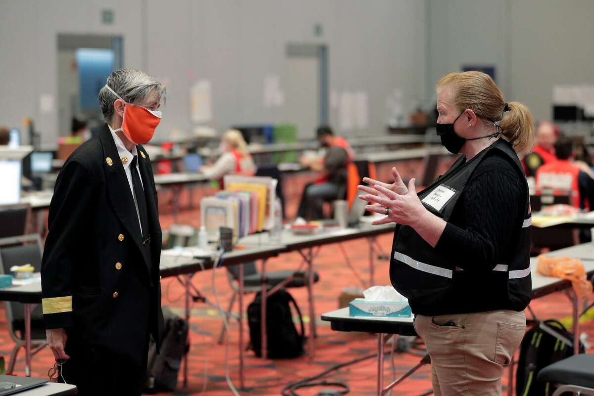 Current San Francisco Fire Chief Jeanine Nicholson, left, chats wtih former chief, Joanne Hayes-White, right, at George R. Moscone Convention Center South where the Emergency Operations Center for the city has replaced city hall in San Francisco, Calif., on Tuesday, April 21, 2020. It's the closest thing that SF has to a City Hall right now, where wide hallways and massive meeting rooms designed for large crowds instead is very loosely filled with hundreds of city workers involved in battling COVID-19's impact on the city.