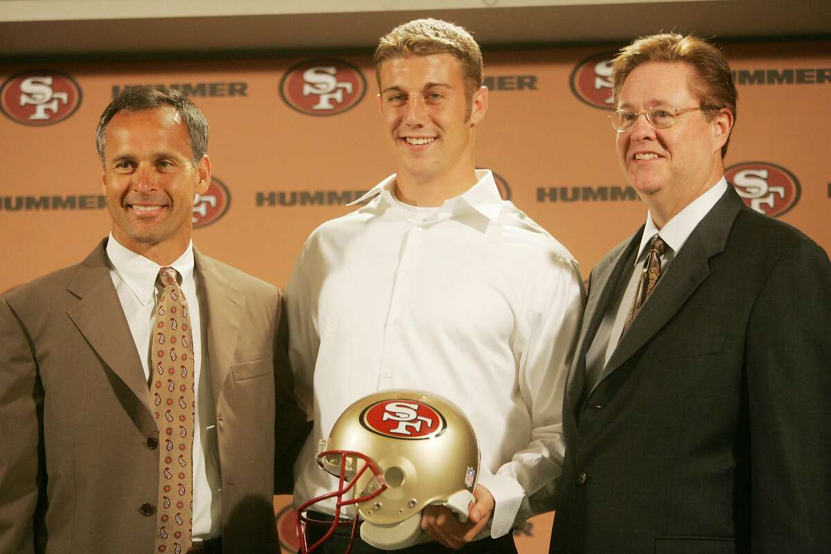Flanked by head coach Mike Nolan and Owner John York, 49ers No. 1 pick Alex Smith announces a new $24 million contract.