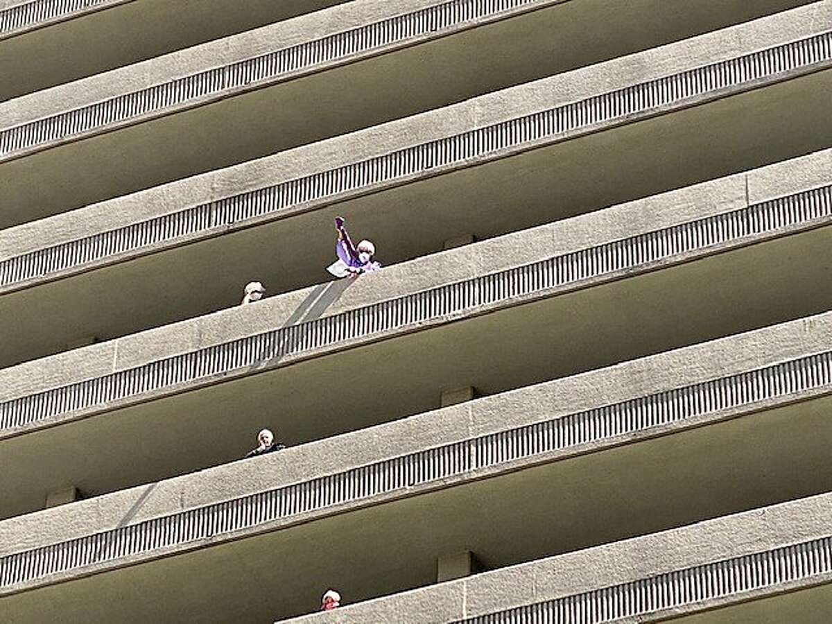 residents on the balconies at 16-story Piedmont Gardens senior complex in Oakland singing along with hootenanny Club playing in downstairs courtyard in weekly singalong