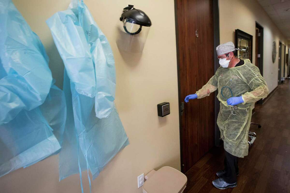Dr. Mike Cantu walks into an examination room to see a patient at Texas Emergency Care Center on Wednesday, April 22, 2020 in Atascocita. The Trump administration approved Tuesday to allow freestanding emergency rooms in Texas to apply for certification as a Medicaid-certified hospital.