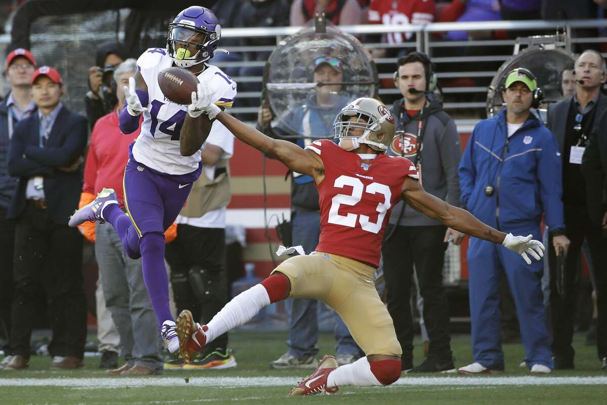 FILE - In this Jan. 11, 2020, file photo, Minnesota Vikings wide receiver Stefon Diggs (14) catches a touchdown pass in front of San Francisco 49ers cornerback Ahkello Witherspoon (23) during the first half of an NFL divisional playoff football gamein Santa Clara, Calif. Buffalo Bills general manager Brandon Beane made a bold move in the offseason by giving up four draft picks _ including the 22nd overall _ to acquire Stefon Diggs in a trade with the Minnesota Vikings. The Bills are left with seven picks over the final six rounds, starting with No. 54. (AP Photo/Marcio Jose Sanchez, File)