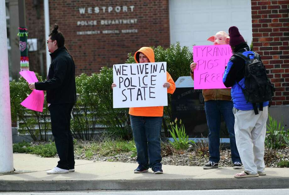 Protestors gather outisde the Westport Police Department Wednesday in Westport. The group was protesting the use of drones by the department to surveil residents diagnosed with coronavirus. Photo: Erik Trautmann / Hearst Connecticut Media / Norwalk Hour