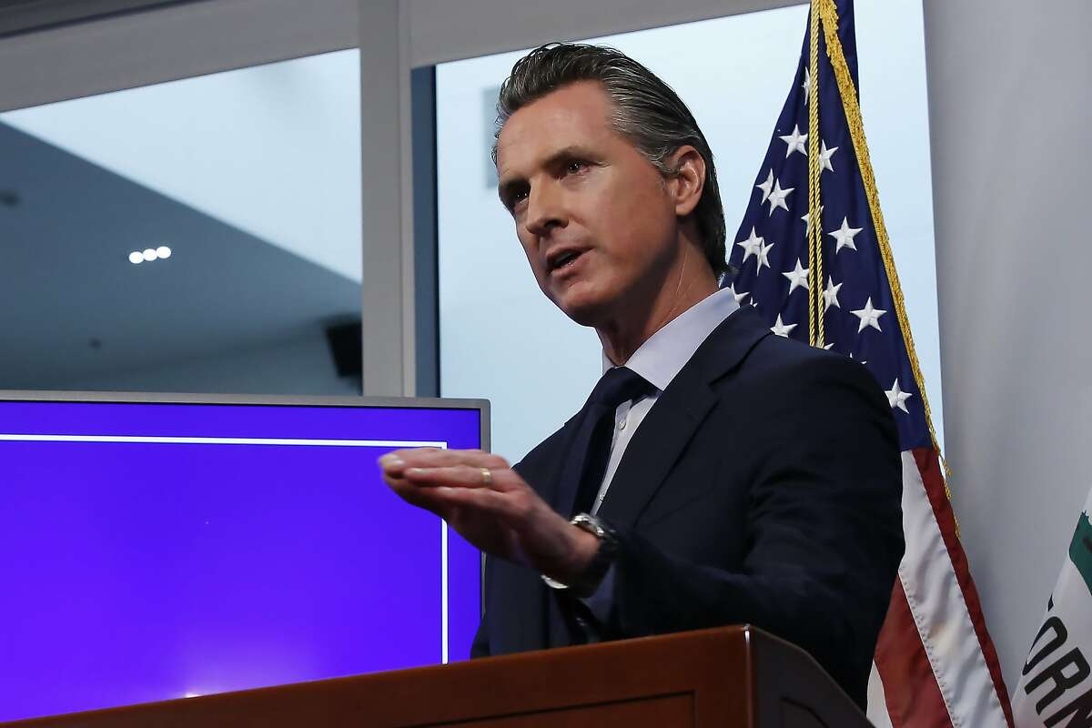 FILE- In this Tuesday April 14, 2020, file photo, California Gov. Gavin Newsom discusses an outline for what it will take to lift coronavirus restrictions, during a news conference at the Governor's Office of Emergency Services in Rancho Cordova, Calif. On Wednesday, April 22, Newson announced hospitals can resume scheduled surgeries. It's the first significant change to the state's stay-at-home order. (AP Photo/Rich Pedroncelli, File)