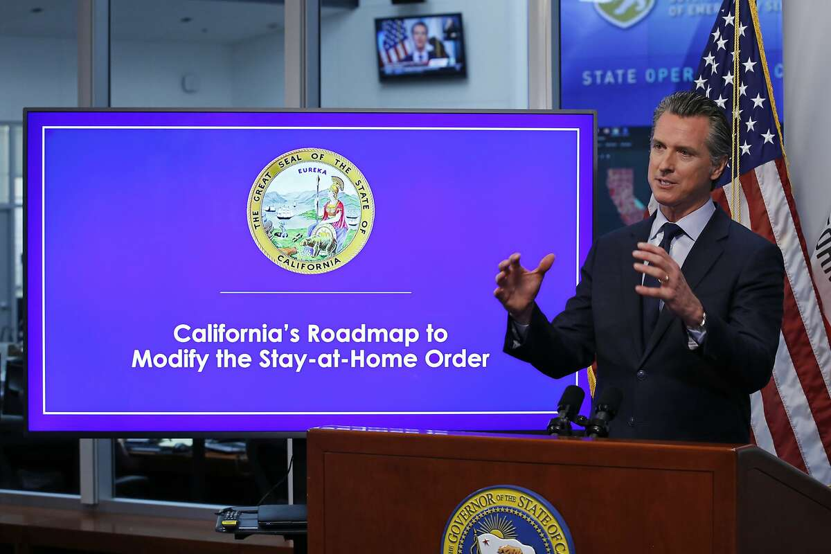 FILE - In this April 14, 2020, file photo, California Gov. Gavin Newsom gestures during a news conference at the Governor's Office of Emergency Services in Rancho Cordova, Calif. On Wednesday, April 22, Gov. Newsom is scheduled to give an update on the six indicators state officials are watching to determine when they might loosen the state's stay-at-home order to prevent the spread of the coronavirus. (AP Photo/Rich Pedroncelli, Pool, File)