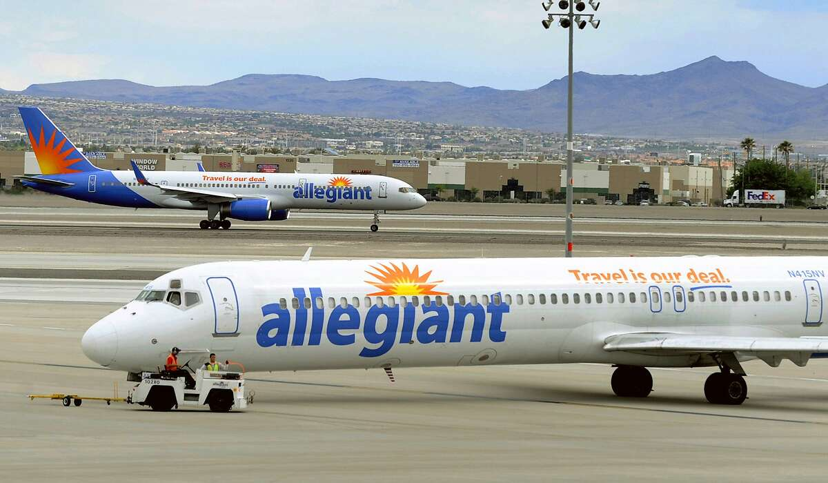 File - In this May 9, 2013, file photo, two Allegiant Air jets taxi at McCarran International Airport in Las Vegas.