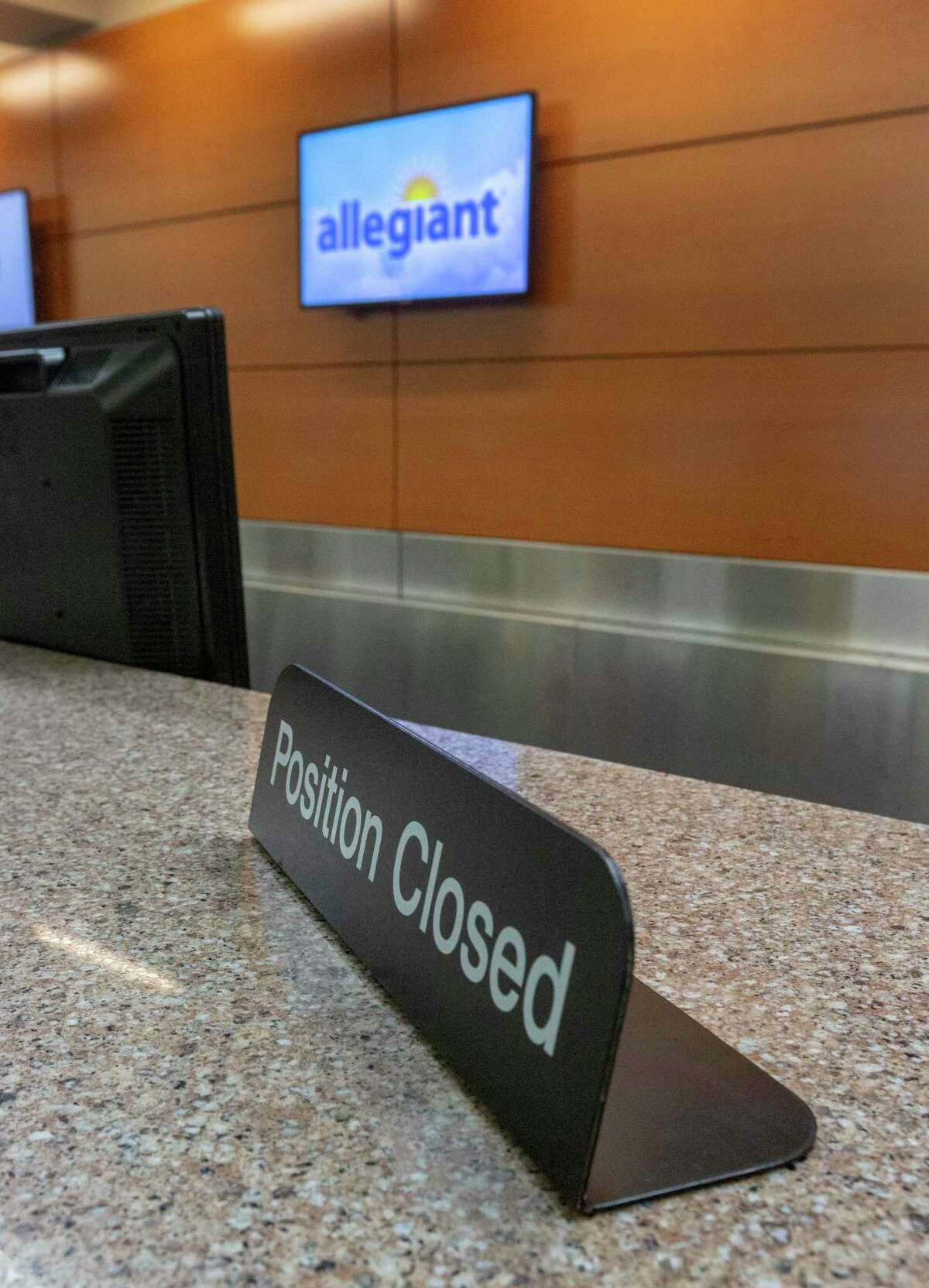 The Allegiant airline ticket counter stands empty Wednesday, April 22, 2020 at the San Antonio International Airport. Despite receiving $172 million in federal stimulus money, Allegiant is asking for a waiver from the government to allow it to cut San Antonio service.
