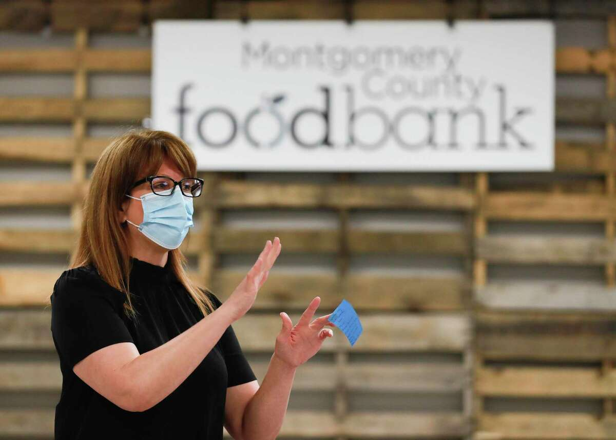 Allison Hulett, former president and CEO of the Montgomery County Food Bank, speaks to members of the National Guard before the help sort and box donated food, Tuesday, April 21, 2020, in Conroe. The organization's board of directors just recently announced the search for Hulett's successor.