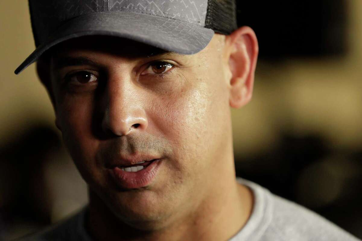 FILE - In this Dec. 9, 2019, file photo, then-Boston Red Sox manager Alex Cora speaks during the Major League Baseball winter meetings in San Diego. The Boston Red Sox were stripped of their second-round pick in this yeara€™s amateur draft by Major League Baseball for breaking video rules in 2018 and former manager Alex Cora was suspended through the 2020 postseason for his conduct as bench coach with the Houston Astros the previous year. Baseball Commissioner Rob Manfred announced his decision Wednesday, April 22, 2020, concluding Red Sox replay system operator J.T. Watkins used in-game video to revise sign sequences provided to players. (AP Photo/Gregory Bull, File)