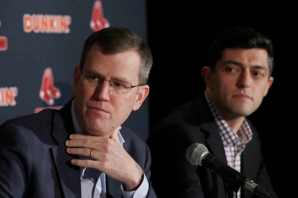 FILE - In this Jan. 15, 2020, file photo, Boston Red Sox team CEO Sam Kennedy, left, and Chief Baseball Officer Chaim Bloom participate during a news conference at Fenway Park in Boston. The Boston Red Sox were stripped of their second-round pick in this yeara€™s amateur draft by Major League Baseball for breaking video rules in 2018 and former manager Alex Cora was suspended through the 2020 postseason for his conduct as bench coach with the Houston Astros the previous year. Baseball Commissioner Rob Manfred announced his decision Wednesday, April 22, 2020, concluding Red Sox replay system operator J.T. Watkins used in-game video to revise sign sequences provided to players. (AP Photo/Elise Amendola, File)