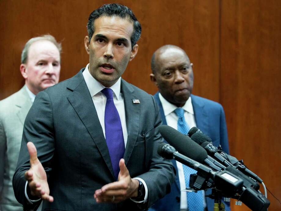 George P. Bush, commissioner of the General Land Office, stands with Mayor Sylvester Turner as he discusses long-term Hurricane Harvey recovery funds during a news conference at the Houston City Hall Annex on Thursday, June 28, 2018, in Houston.( Brett Coomer / Houston Chronicle ) Photo: Brett Coomer, Staff / Houston Chronicle / © 2018 Houston Chronicle