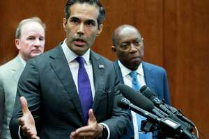 George P. Bush, commissioner of the General Land Office, stands with Mayor Sylvester Turner as he discusses long-term Hurricane Harvey recovery funds during a news conference at the Houston City Hall Annex on Thursday, June 28, 2018, in Houston.( Brett Coomer / Houston Chronicle )