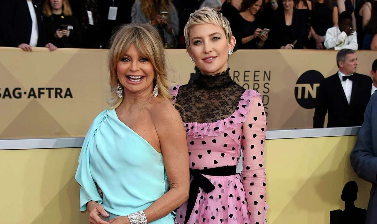 FILE - In this Jan 21, 2018 file photo, Goldie Hawn, left, and her daughter Kate Hudson arrive at the 24th annual Screen Actors Guild Awards in Los Angeles. Three generations will grace the cover of People magazine for the first time in the 30-year history of the a€œBeauiful Issue.a€ Goldie Hawn, her daughter Kate Hudson and granddaughter Rani Rose Fujikawa will appear on the cover, which will be released Friday. (Photo by Jordan Strauss/Invision/AP, File)
