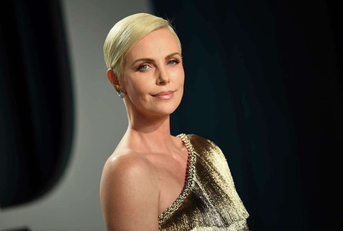 FILE - This Feb. 9, 2020 file photo shows actress Charlize Theron at the Vanity Fair Oscar Party in Beverly Hills, Calif. Theron and her foundation are committing $1 million to coronavirus relief efforts, with half dedicated to fighting gender-based violence resulting from the outbreak. (Photo by Evan Agostini/Invision/AP, File)