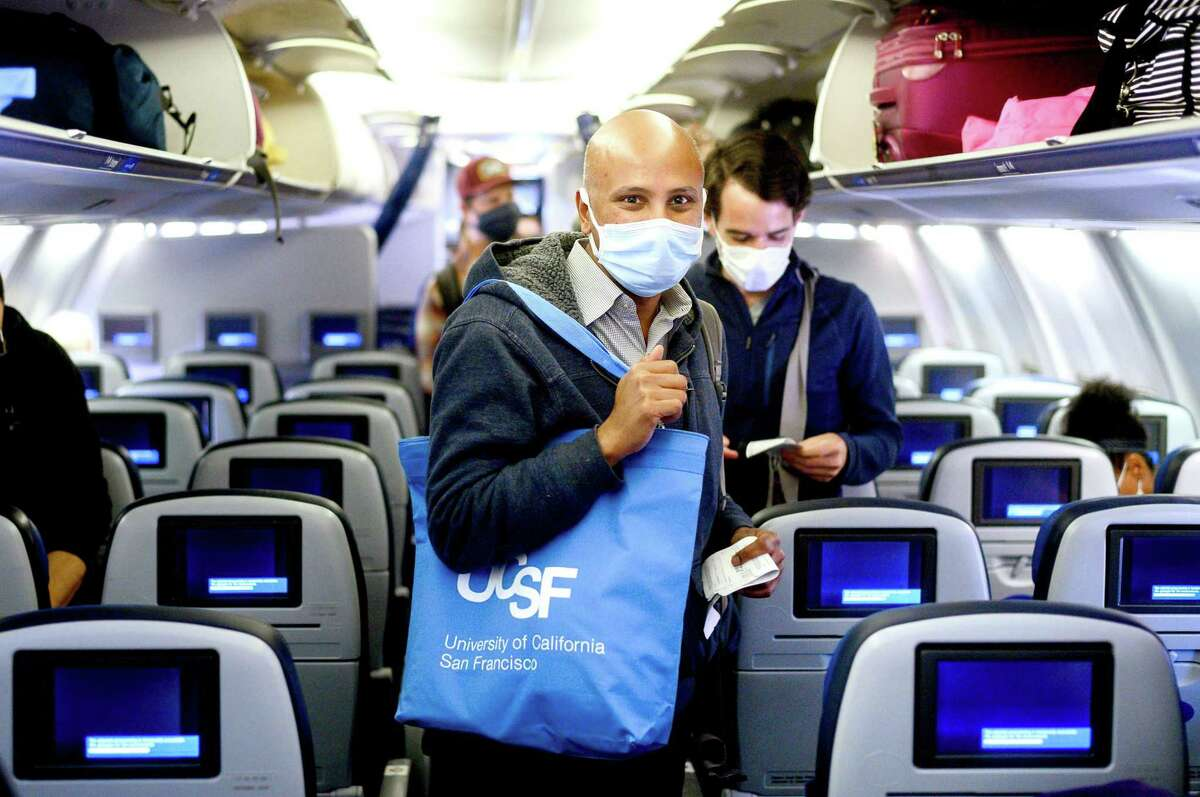 UCSF Dr. Sriram Shamasunder, co-founder of the HEAL Initiative, boards a flight at San Francisco International Airport while en route to Navajo Nation to treat COVID-19 patients on Wednesday, April 22, 2020. A group of UCSF staff including 14 nurses and seven doctors volunteered for the assignment in Navajo Nation hospitals in Arizona and New Mexico.