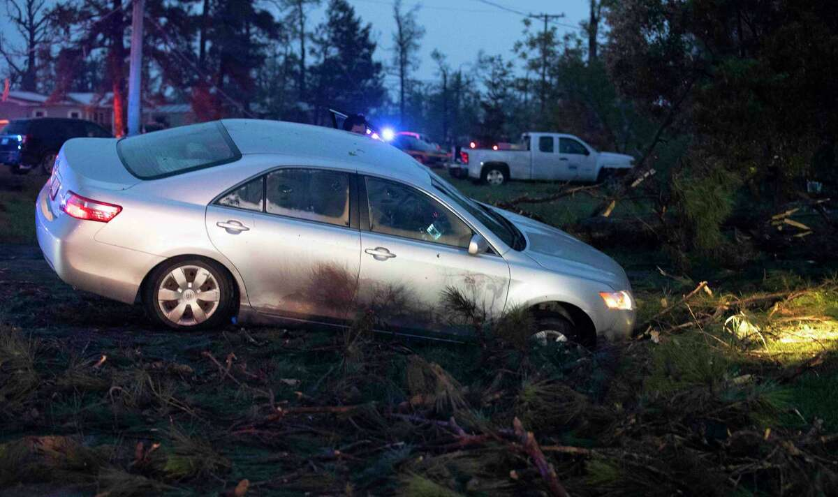 A car is seen in a ditch in Onalaska, Texas, after a tornado touched down in the area Wednesday, April 22, 2020. (Jason Fochtman/Houston Chronicle via AP)
