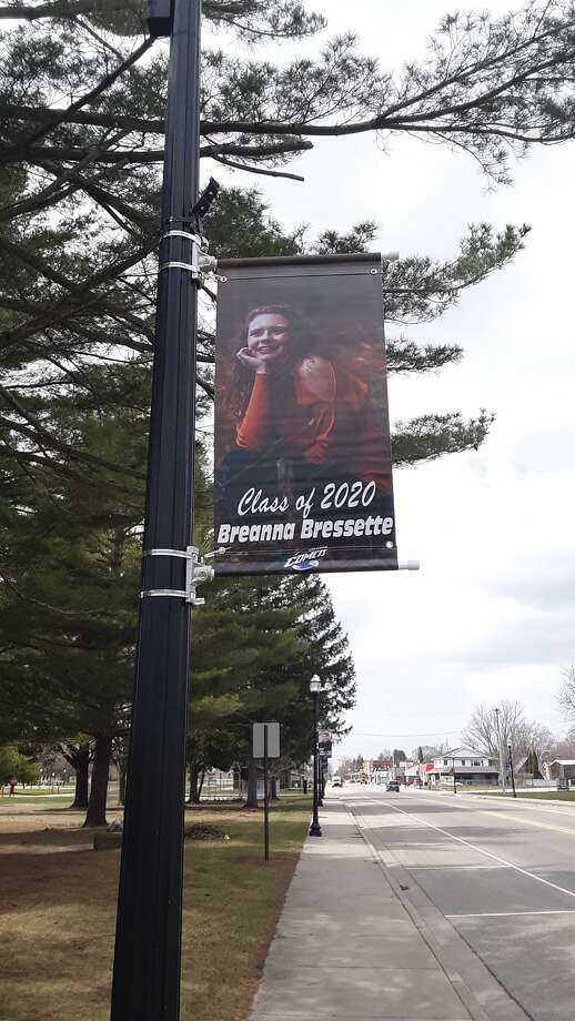 Coleman Community Schools, with help from many individuals, groups and businesses in the community, produced banners recognizing each of the 48 members of Coleman High School's graduating class of 2020. The banners were hung on Tuesday on lamp posts on both sides of Railway Street for passersby to see for the next month or so. Photo: Dan Chalk/chalk@mdn.net
