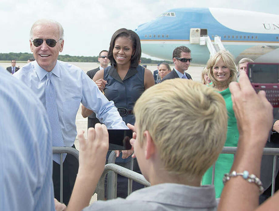 Former Vice President Joe Biden (from left), first lady Michelle Obama and Jill Biden greet people on the tarmac as they arrive at Portsmouth International Airport at Pease, in Newington, New Hampshire in 2012. Seeking to unite Democrats, Joe Biden has raced to line up supporters ranging from progressive icon Bernie Sanders to former President Barack Obama, whose administration sometimes irked liberals. But the person with the most influence may be Michelle Obama. Photo: Carolyn Kaster | AP