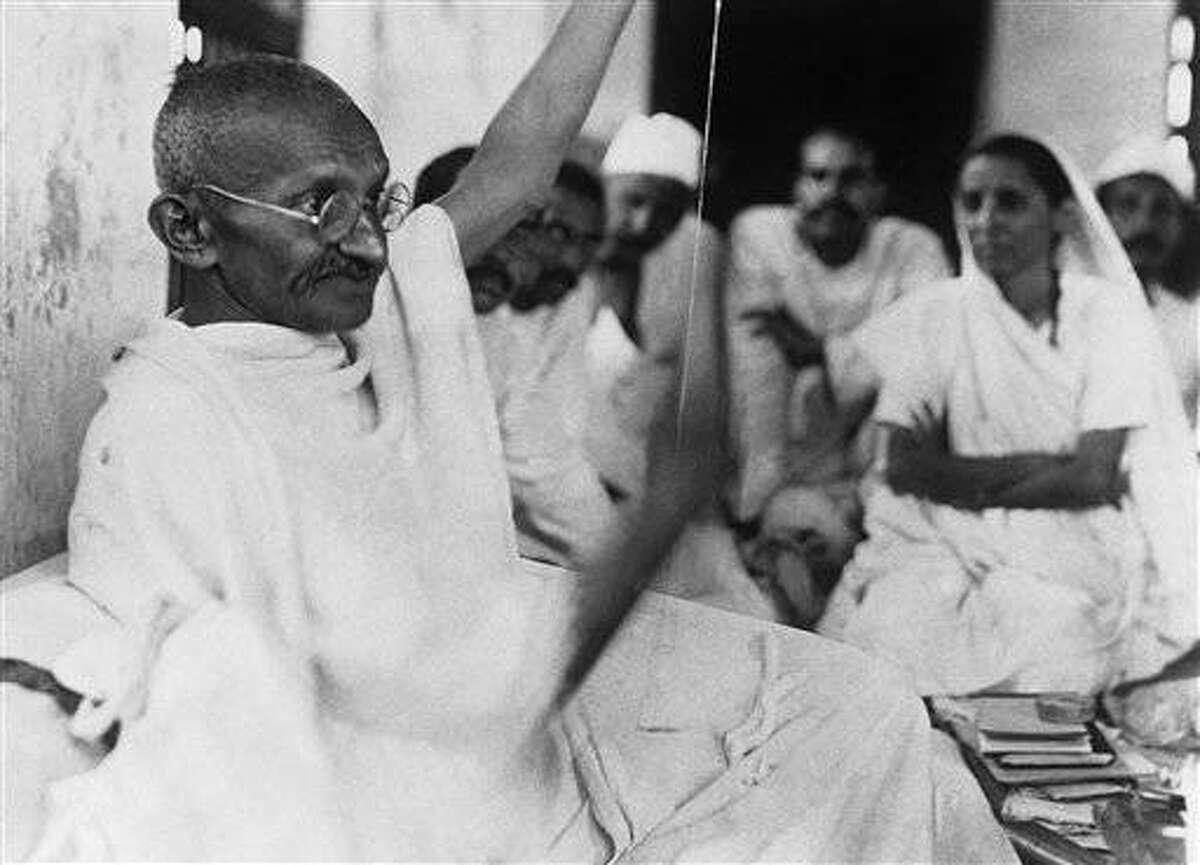 Mahatma Gandhi spinning around April 23, 1930. (AP Photo)