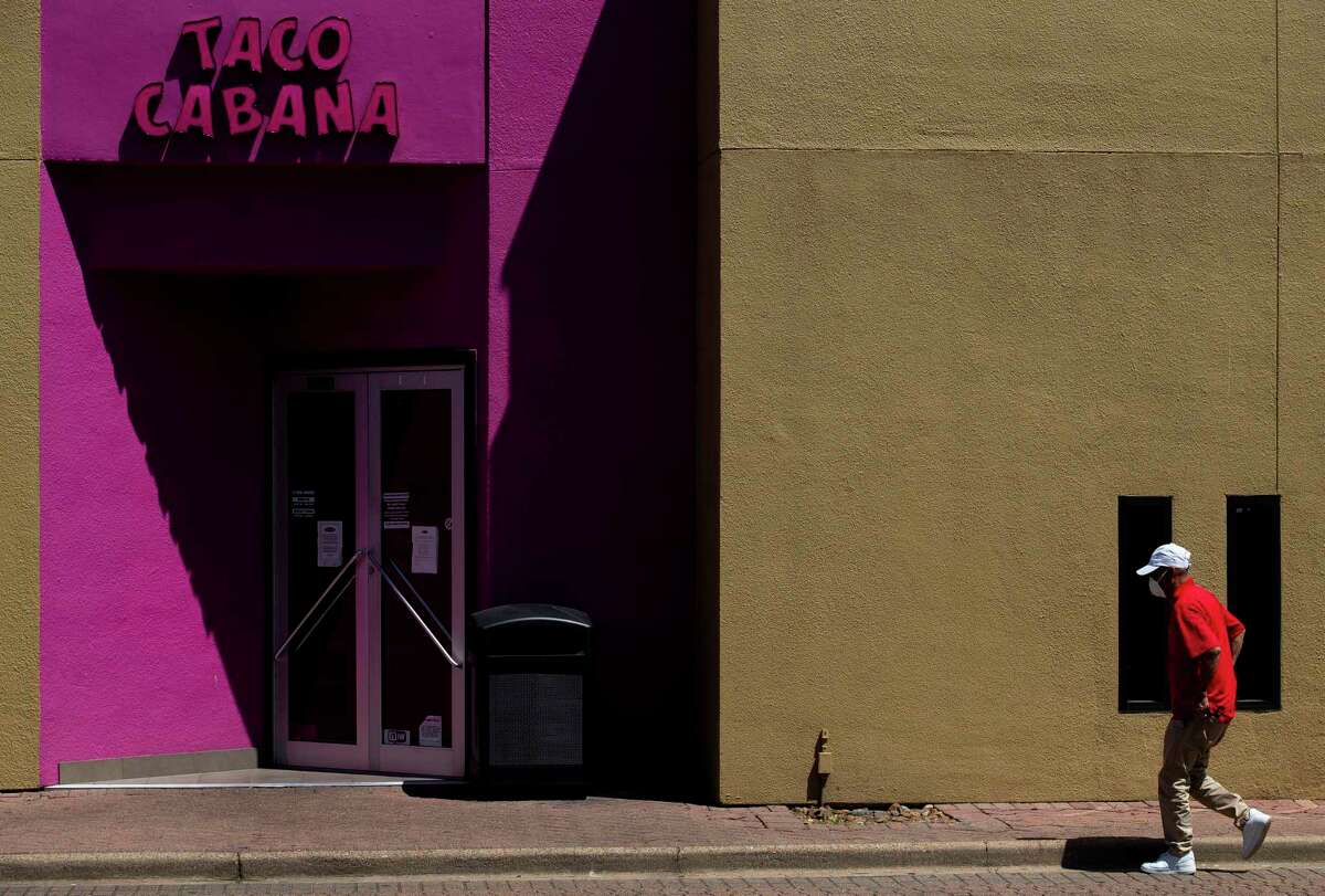 A customer walks into a Taco Cabana restaurant, April 16, in Houston. Taco Cabana received ia forgivable loan through the Small Business Administration, helping it retain employees and stay afloat while the economy is shut down due to the COVID-19 pandemic. Large chains such as Taco Cabana form a sizable percentage of the 88,000 Texas businesses that received the loans. One reader questions why Taco Cabana received a loan, arguing it was intended for smaller businesses.