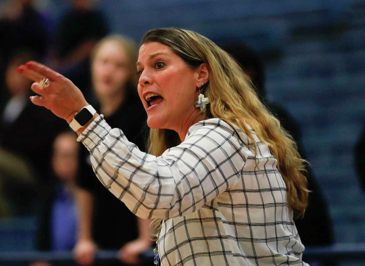 New Caney head coach Tricia Mize instructs players during the first quarter of a District 20-5A high school basketball game at New Caney High School, Tuesday, Dec. 10, 2019, in New Caney.
