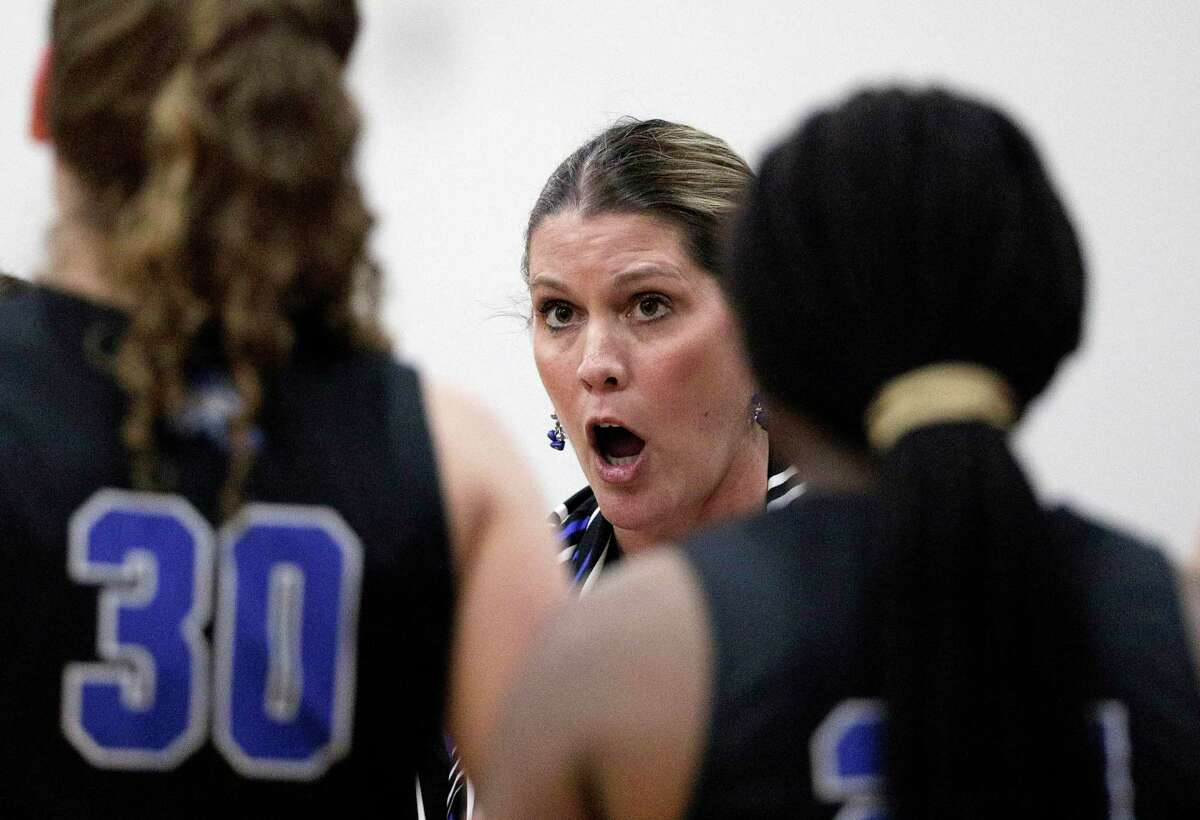New Caney head coach Tricia Mize talks with her players during a timeout in the first half of their game against Willis Tuesday, Nov. 27, 2018, in Willis, TX.