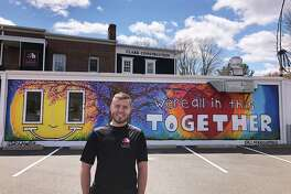Ross Clark's upbeat mural is easily visible to southbound drivers on Route 7 in Branchville.