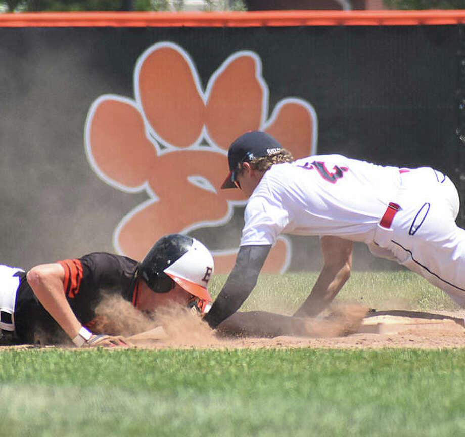 Gavin Huebner slides safely back into second base after a game last season for the Edwardsville Tigers inside the District 7 Sports Complex. Photo: Matt Kamp|The Intelligencer