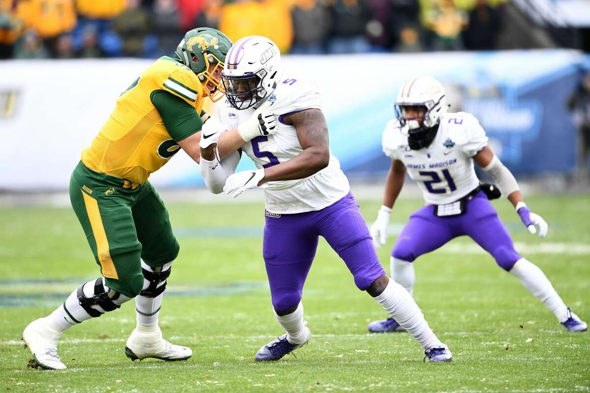 FRISCO, TX - JANUARY 11: Cordell Volson #67 of the North Dakota State Bison blocks Ron'Dell Carter #5 of the James Madison Dukes during the Division I FCS Football Championship held at Toyota Stadium on January 11, 2020 in Frisco, Texas. (Photo by Justin Tafoya/NCAA Photos via Getty Images)