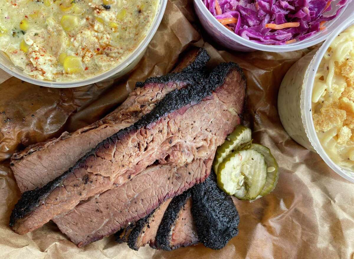 Takeout options at 2M Smokehouse include, clockwise from top left, Mexican street corn, cole slaw, chicharrón macaroni and cheese and smoked brisket.
