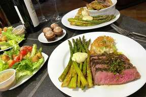 A recent Feed Me To-Go spread from Clementine included grilled flank steak, asparagus, mashed potatoes, a Caesar salad and chocolate moelleux and the option of a vegetarian frittata.
