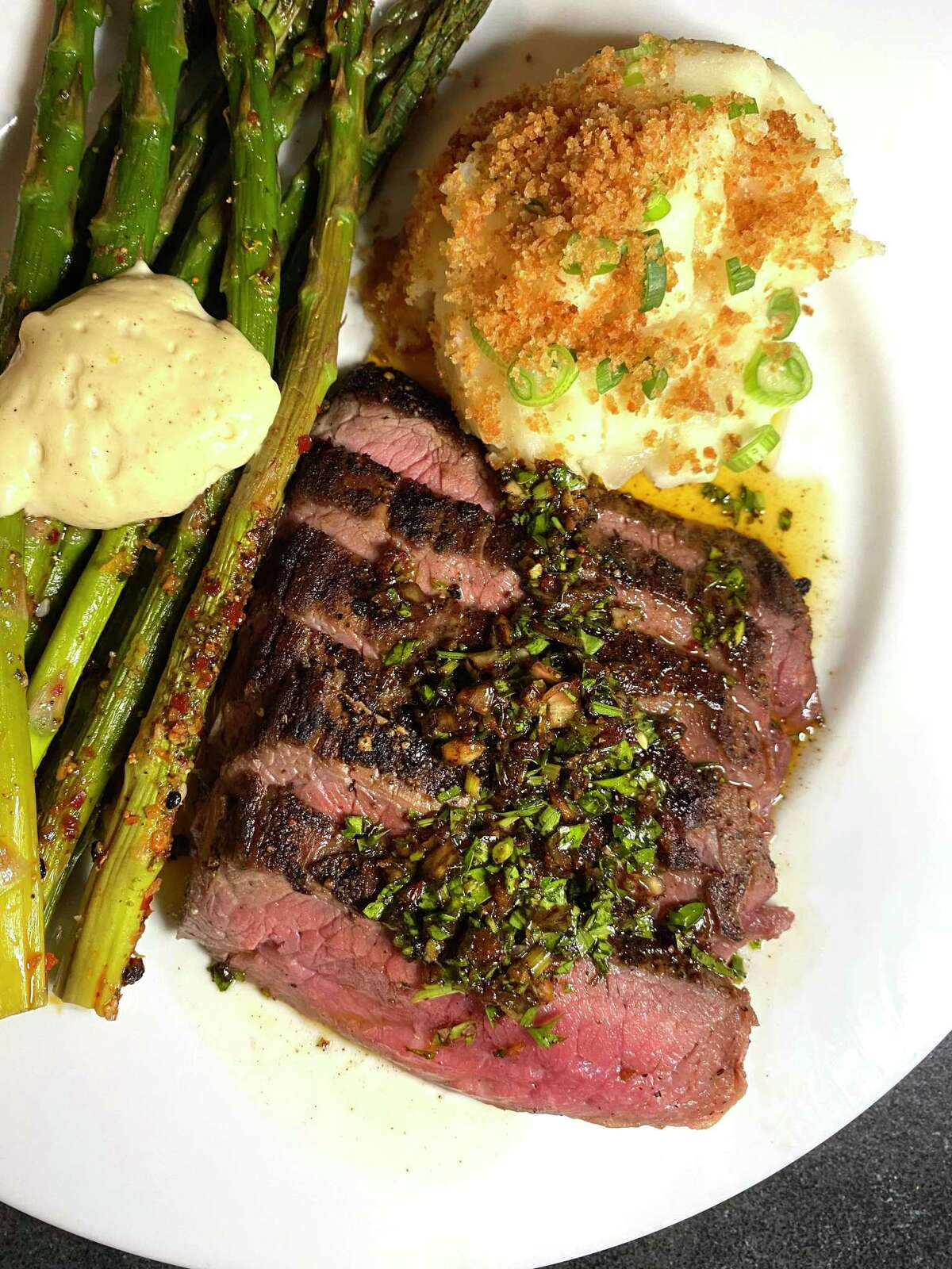 A recent Feed Me To-Go dinner from Clementine included grilled flank steak, asparagus and mashed potatoes.