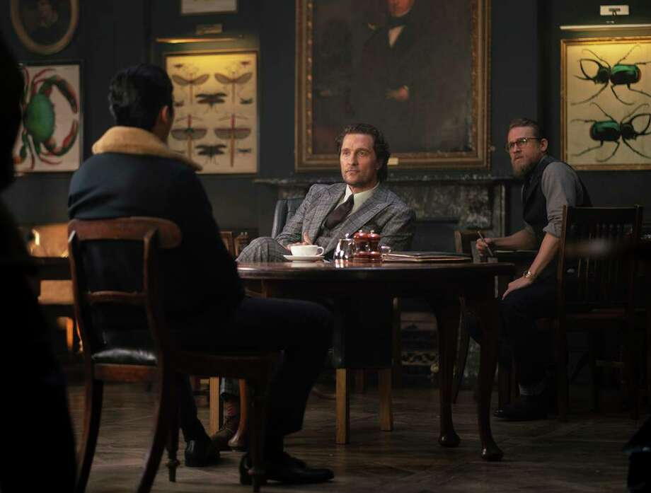 """This image released by STXfilms shows, from left, Henry Golding, Matthew McConaughey and Charlie Hunnam in a scene from """"The Gentlemen."""" (Christopher Raphael/STXfilms via AP) Photo: Christopher Raphael, HONS / AP / STXfilms"""
