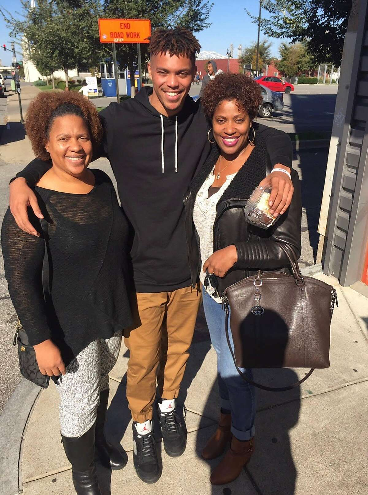 Damion Lee poses with his mother, Michelle Riddick (right), and aunt, Cynthia Riddick-Hall (left).