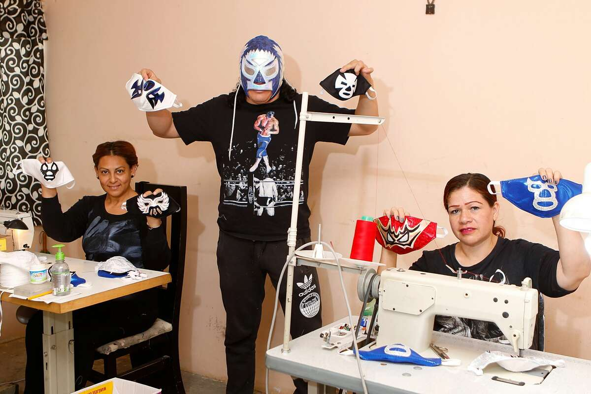 TORREON, MEXICO - APRIL 21: Mexican Lucha Libre wrestler, 'El Hijo del Soberano' and his workers show some wrestlers face masks on April 21, 2020 in Torreon, Mexico. Due to the COVID-19 pandemic, 'El Hijo del Soberano' turned to produce themed protective masks in a studio with his family. (Photo by Armando Marin/Jam Media/Getty Images)