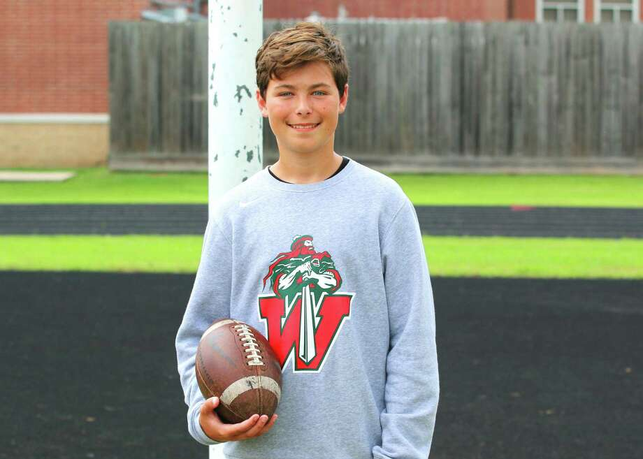 "The Woodlands High School freshman JW Painter took part in his own created ""Kicking 22 Challenge"" to raise awareness for the 22 veterans who commit suicide every day. Photo: Submitted Photo"