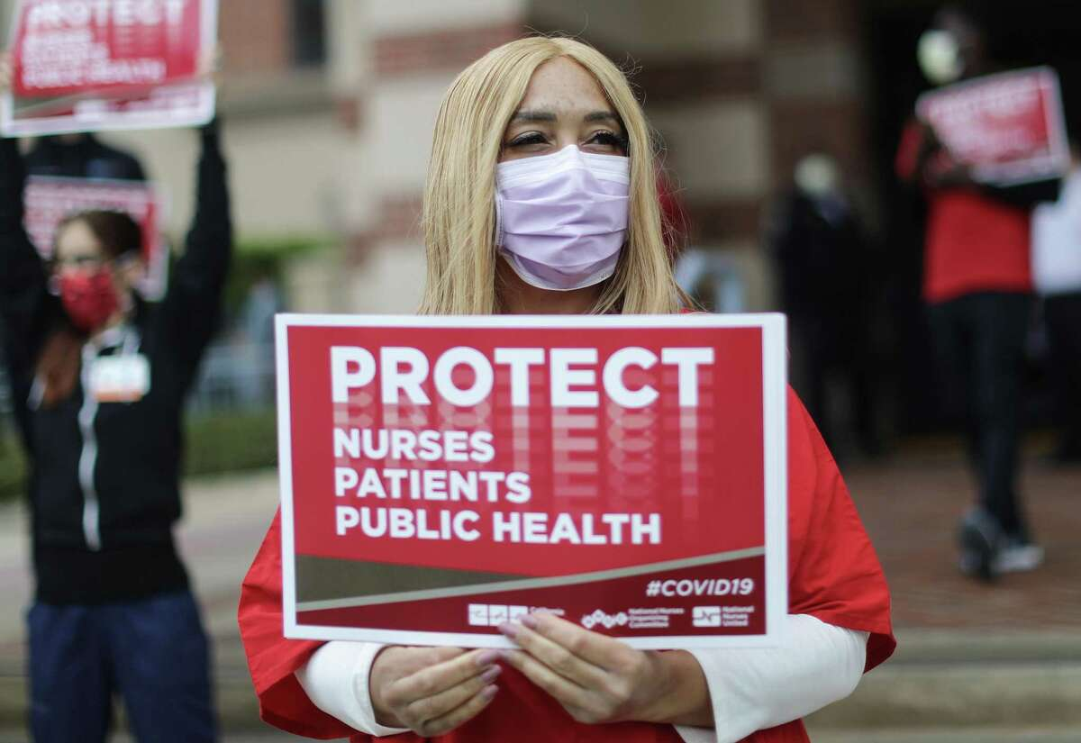 Registered nurses and health care workers protest what they say is a lack of personal protective equipment available for frontline workers at UCLA Medical Center in Santa Monica, Calif.